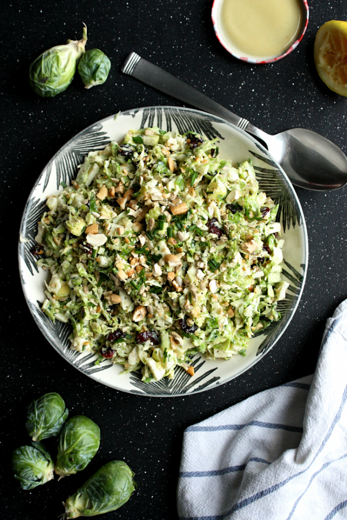 Brussel Sprout Slaw with Cranberries, Cashews, and Apples