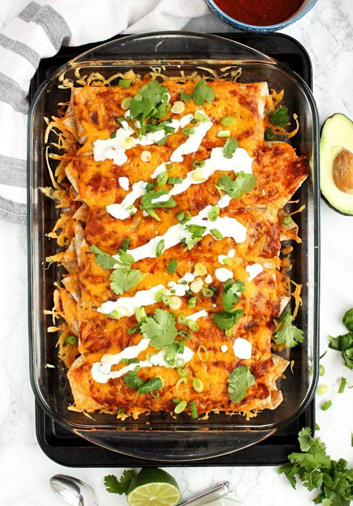 Veggie Enchiladas with Quinoa and Black Beans || These hearty veggie enchiladas are loaded with quinoa, spinach, black beans, spices and topped with an easy homemade enchilada sauce. #mondaysundaykitchen
