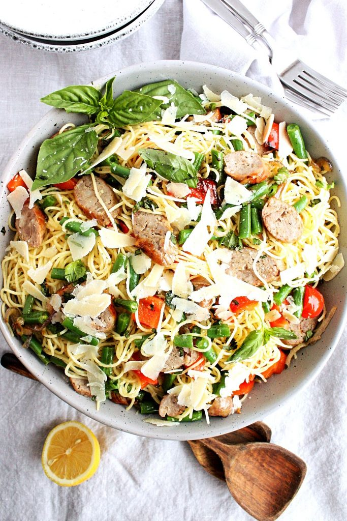 Grilled Italian sausages, red peppers, fresh basil, garden beans, and parmesan tossed with pasta and a light, bright lemon and olive oil dressing.