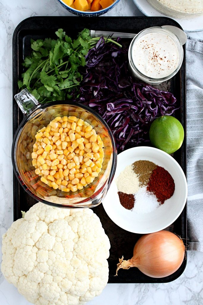The ingredients you need for sheet pan veggie tacos.