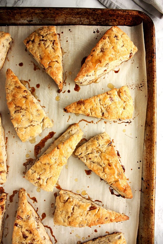 Maple pecan scones on a baking tray just out of the oven