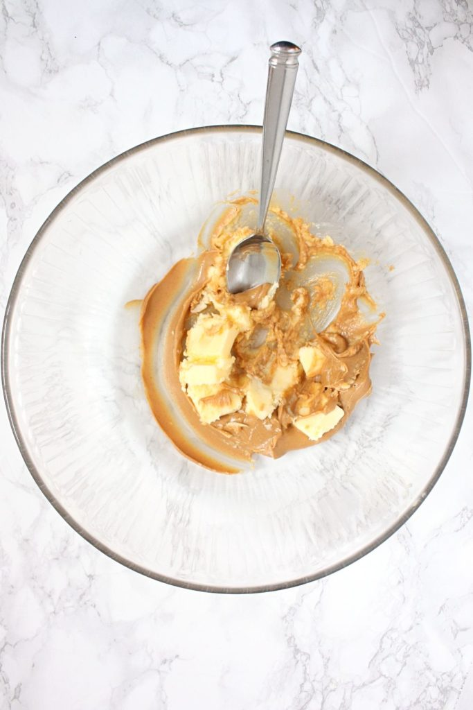 Creaming peanut butter and butter in a mixing bowl.
