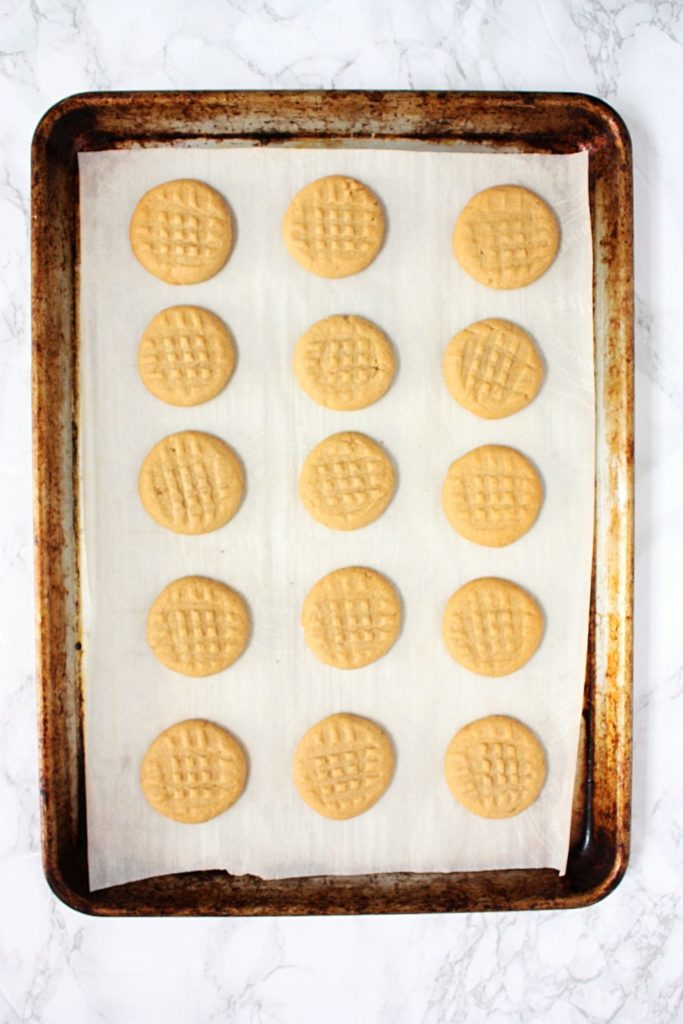 Peanut Butter Shortbread Cookies fresh out of the oven on a baking tray.