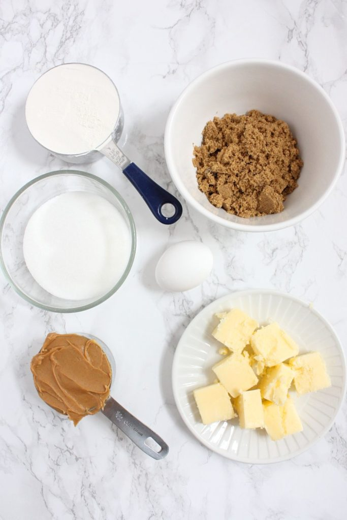 Cookies ingredients: softened butter, peanut butter, brown sugar, sugar, all-purpose flour, and an egg.